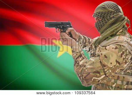 Male In Muslim Keffiyeh With Gun In Hand And National Flag On Background - Burkina Faso