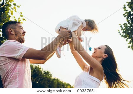 Parents and kid spending time