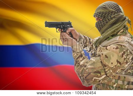 Male In Muslim Keffiyeh With Gun In Hand And National Flag On Background - Colombia