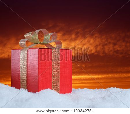 gift on snow in the night sky