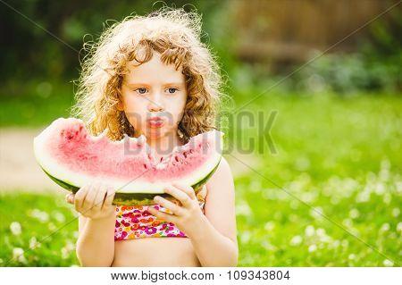 Little Girl Eating Watermelon In Summer Park. Instagram Filter.