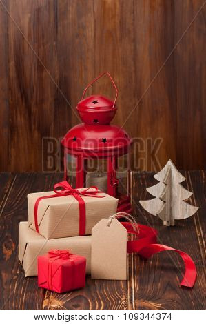 Gift Box With Blank Tag. Christmas Decorations. Wooden Backgroun