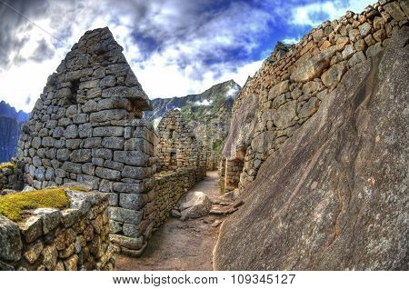 Stones and ruined houses in of the lost Incan city - the Machu Picchu