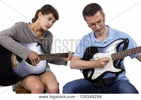 Music Teacher and Student with Guitar