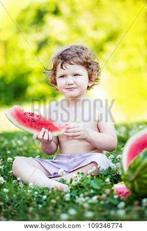 Happy Little Boy Eating Watermelon  In Summer Park.