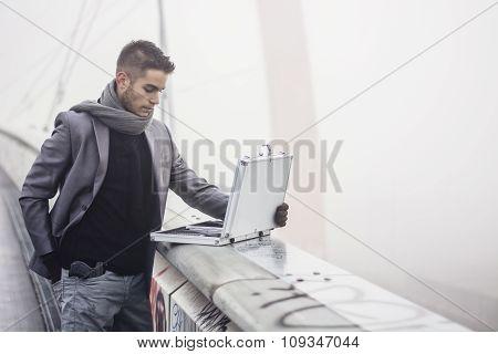 Stylish elegant businessman opening a briefcase