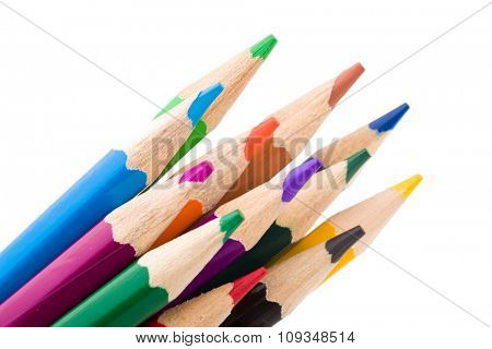 Many different colored pencils on white background.