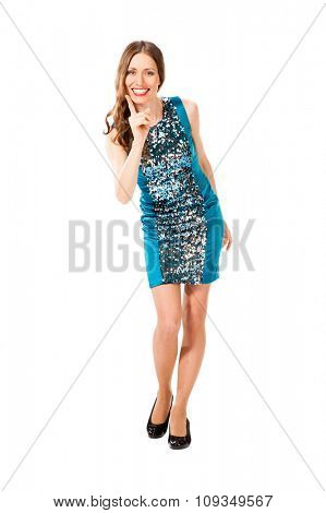 Young slim pretty woman in blue dress with sequins threatens a finger isolated on white background