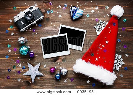 Christmas And New Year Background With Old Camera, Santa's Hat, Photo Frames and Decorations