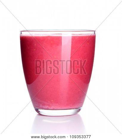 Glass of raspberry milk shake on light background