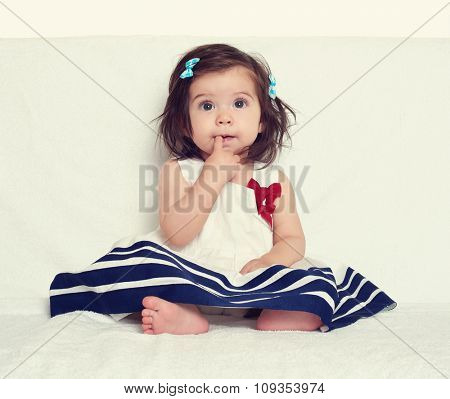 baby girl portrait, sit on white towel