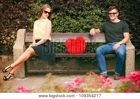 Couple With Heart Sitting In Park