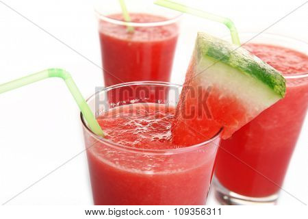 Glasses of watermelon juice isolated on white