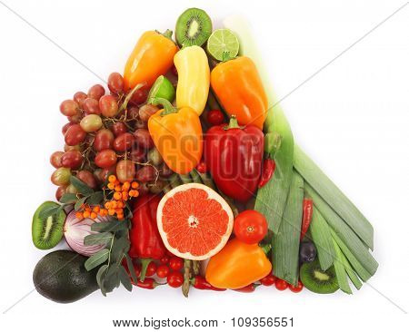Close-up composition of various raw organic vegetables and fruit isolated on white