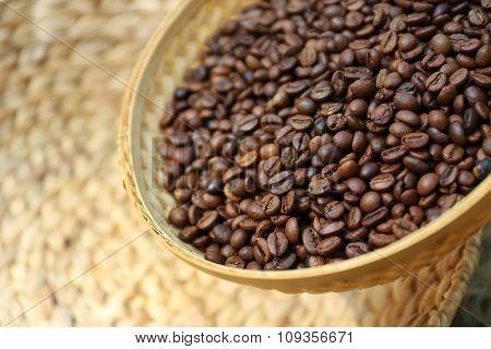 Roasted coffee beans in wattled basket