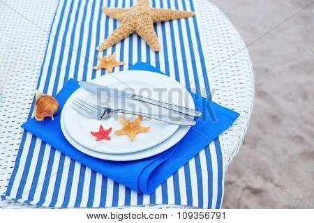 Table setting decorated in marine style