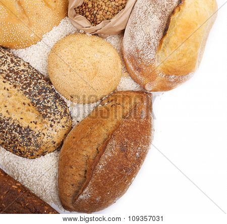 Composition of mixed breads and grains on white background