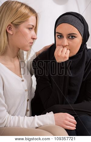 Girl Supporting Arab Woman