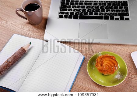 View of comfortable working place on wooden background