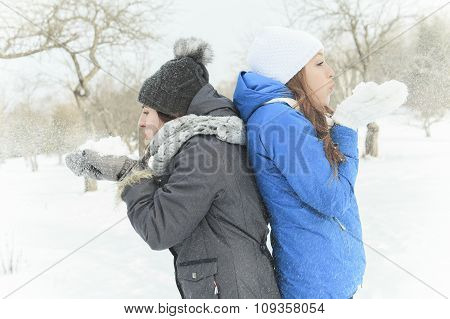 Two happy young girls having fun in winter