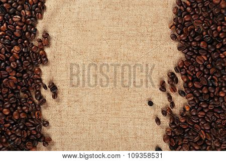 Frame of roasted coffee beans on the linen fabric