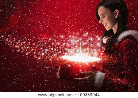 Beautiful girl with christmas magic box