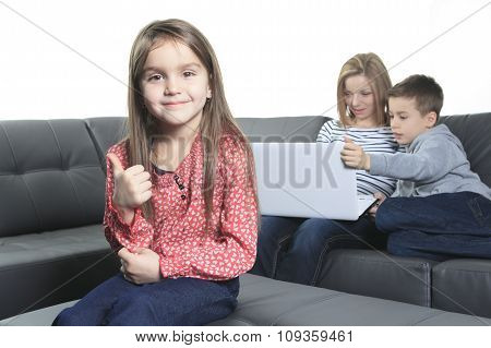 friendly family sitting on the sofa Labtop