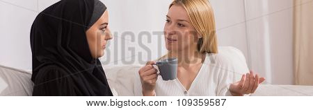 Woman Discussing With Muslim Friend