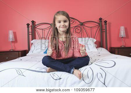 Beautiful little girl sit her bedroom