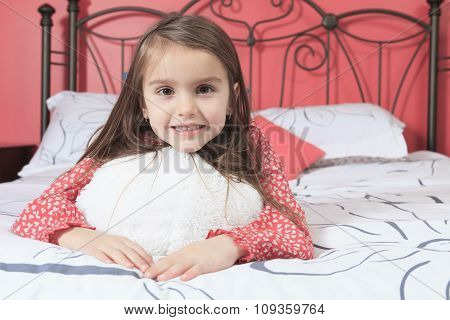 Beautiful little girl on her bedroom