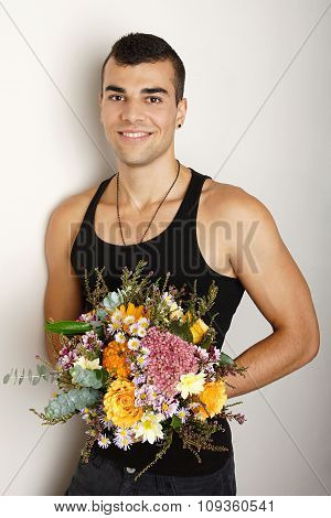 Young man with bouquet of flowers