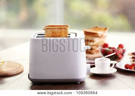 Served table for breakfast with toast and jam, on blurred background