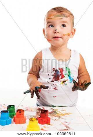 joyful little boy with paints isolated on white background