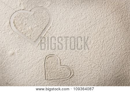 Hearts of flour on wooden background