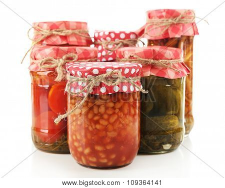 Jars  with pickled vegetables isolated on white