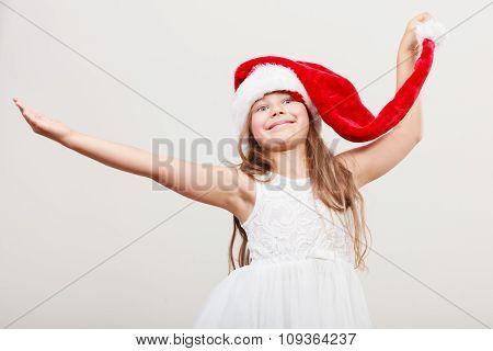 Happy Little Girl Kid In Santa Hat. Christmas.