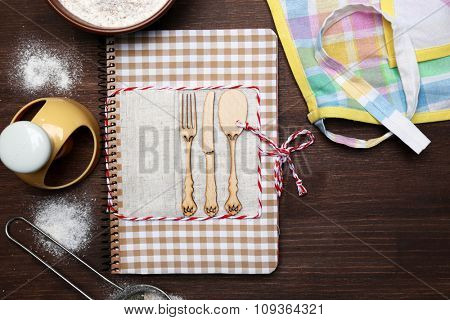 Decorated recipe book on wooden background