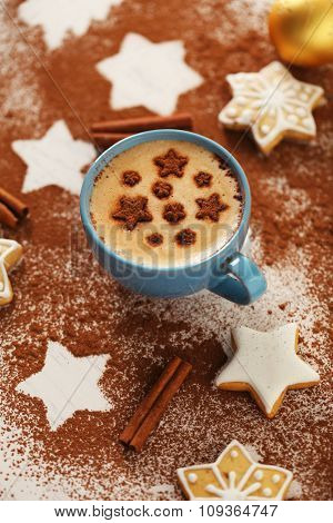 Beautiful composition with cup of cappuccino and Christmas cookies