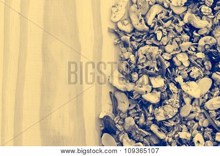 Pile Of Granola Cereal On The Wood Background,film Style Toning