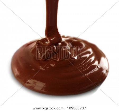 Melted milky brown chocolate pouring, isolated on white