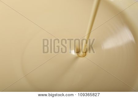 Background of condensed milk in a bowl, close-up