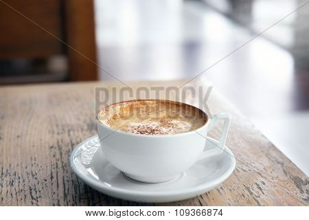 Cup of tasty cappuccino in cafe