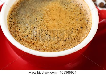 View on coffee foam in the cup, close-up