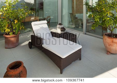 Interior of a modern house;� veranda with chaise longue