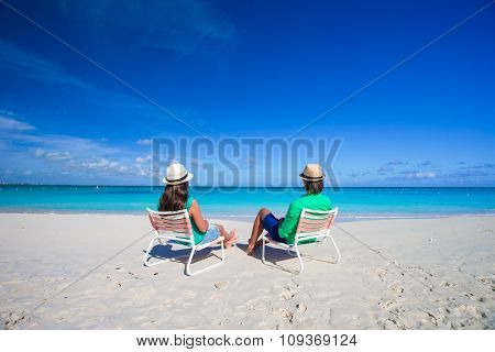 Young happy couple on white beach during vacation