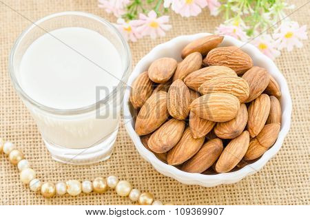 Almond Milk In Glass And Almonds In White Cup.