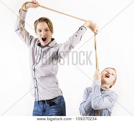 Young teen boys fighting and chocking with a rope.