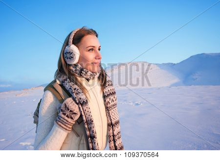 Portrait of cute happy female spending winter holidays in the mountains, enjoying beautiful snowy view, healthy active lifestyle