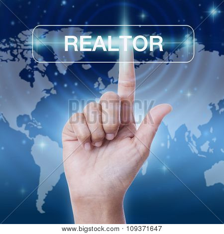 hand pressing realtor word button on virtual screen. business concept