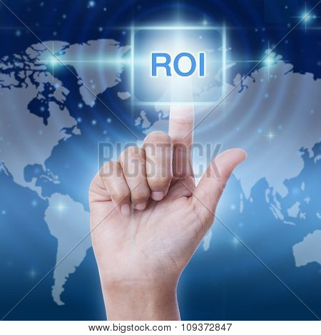 hand pressing ROI (return on investment) sign on virtual screen. business concept